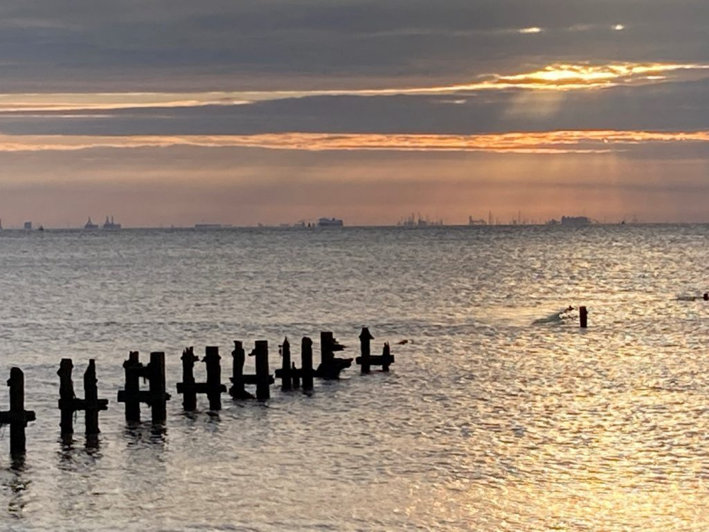 A view from Spurn Point towards the south bank of the Humber showing remnants of a pier