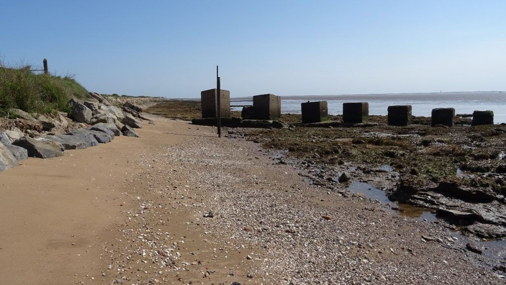 Standing on the banks of the Humber looking towards Spurn with historic concrete defensive structures in view